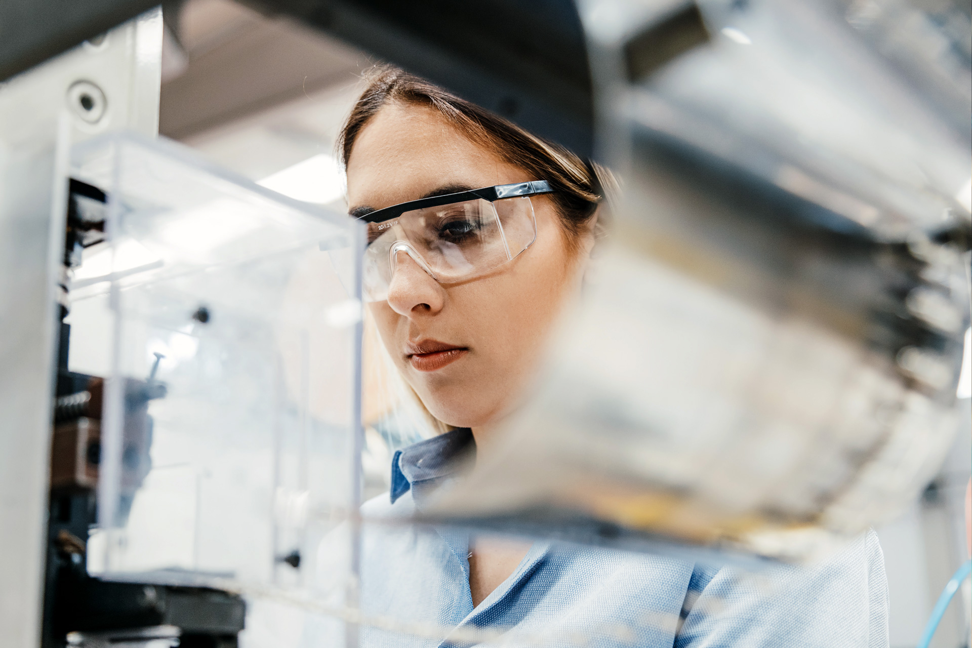 Woman wearing safety glasses working in a laboratory