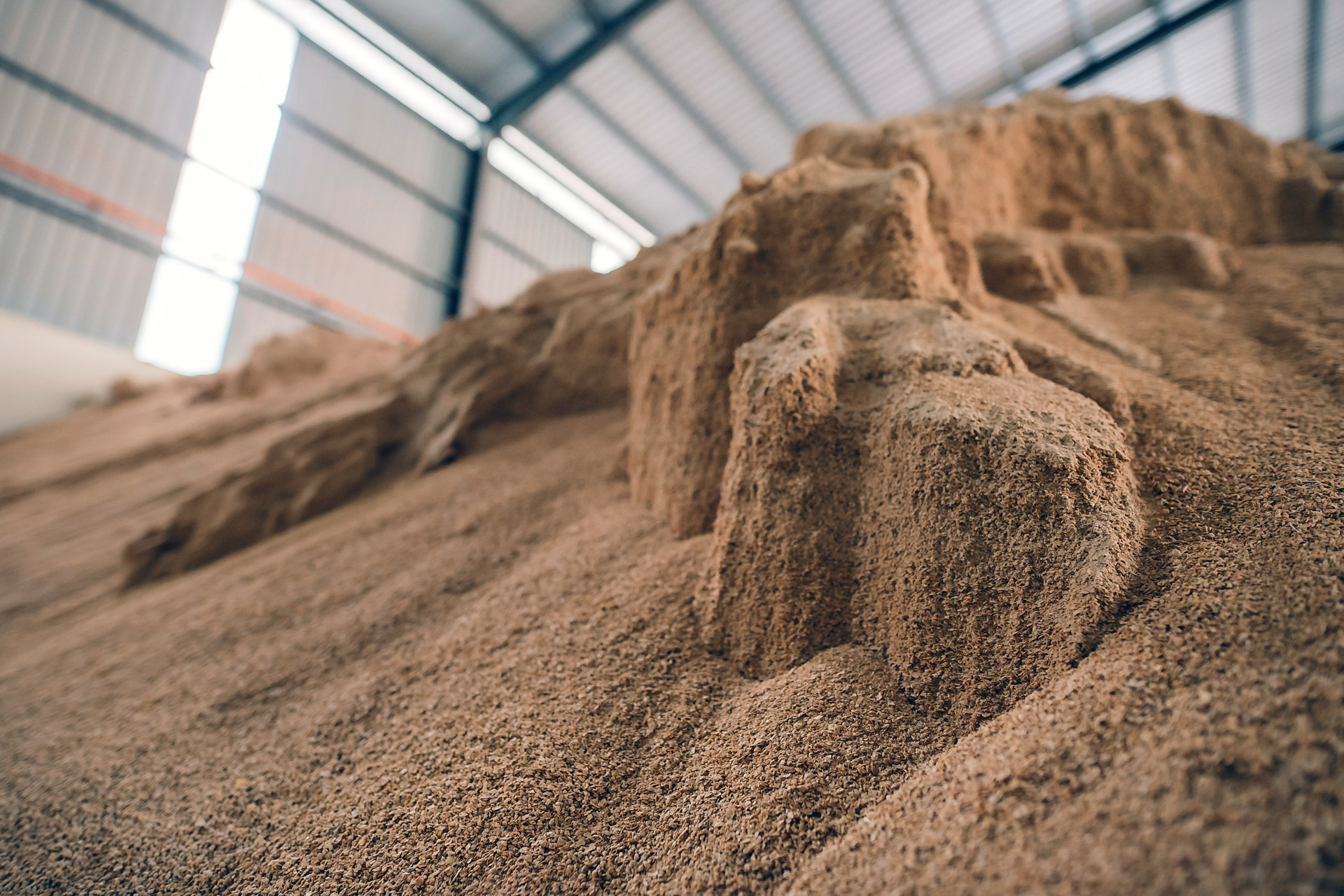 Powdered product in storage building