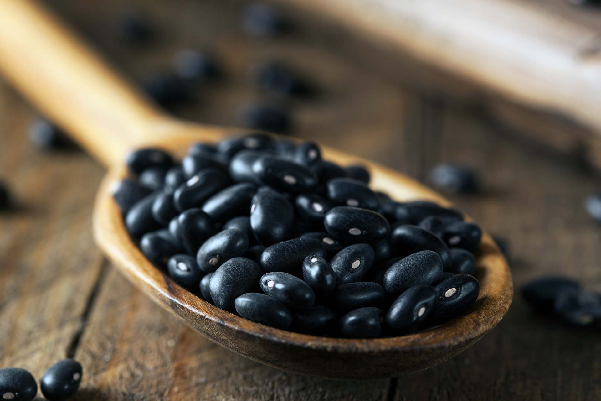black beans in a wooden spoon